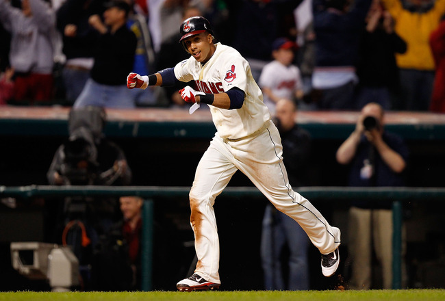 CLEVELAND - APRIL 30:  Michael Brantley #23 of the Cleveland Indians celebrates before scoring the game winning run in the 13th inning on a single by teammate Orlando Cabrera #20 against the Detroit Tigers during the game on April 30, 2011 at Progressive