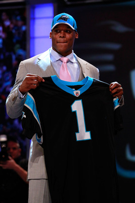 NEW YORK, NY - APRIL 28:  Cam Newton, #1 overall pick by the Carolina Panthers holds up a jersey on stage after he was picked during the 2011 NFL Draft at Radio City Music Hall on April 28, 2011 in New York City.  (Photo by Chris Trotman/Getty Images)