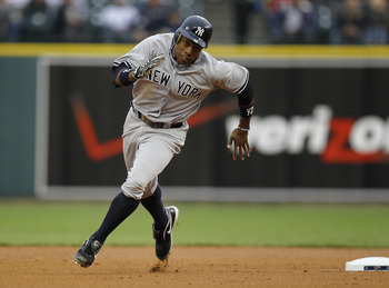 DETROIT, MI - MAY 02:  Curtis Granderson #14 of the New York Yankees runs to third base while playing the Detroit Tigers at Comerica Park on May 2, 2011 in Detroit, Michigan.  (Photo by Gregory Shamus/Getty Images)
