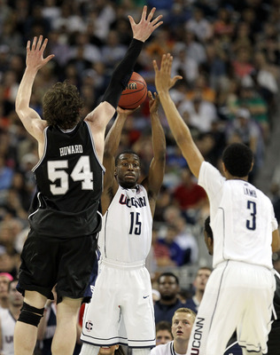 HOUSTON, TX - APRIL 04:  Kemba Walker #15 of the Connecticut Huskies looks to pass the ball to teammate Jeremy Lamb #3 over the arms of Matt Howard #54 of the Butler Bulldogs during the National Championship Game of the 2011 NCAA Division I Men's Basketba