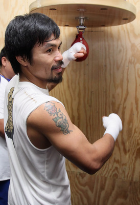HOLLYWOOD, CA - APRIL 20:  Manny Pacquiao of the Philippines trains on the speed bag during a media workout at the Wild Card Boxing Club on April 20, 2011 in Hollywood, California.  (Photo by Jeff Gross/Getty Images)
