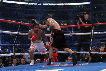 ARLINGTON, TX - NOVEMBER 13:  Manny Pacquiao (white trunks) of the Philippines fights against Antonio Margarito (black trunks) of Mexico during their WBC World Super Welterweight Title bout at Cowboys Stadium on November 13, 2010 in Arlington, Texas.  (Ph