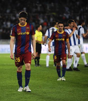 SAN SEBASTIAN, SPAIN - APRIL 30:  Fontas (L) and Xavi Hernandez of FC Barcelona look down dejected at the end of the La Liga match between Real Sociedad and Barcelona at Estadio Anoeta on April 30, 2011 in San Sebastian, Spain. Real Sociedad won 2-1.  (Ph