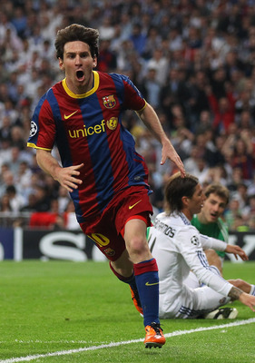 MADRID, SPAIN - APRIL 27: Lionel Messi of Barcelona celebrates after scoring his first goal during the UEFA Champions League Semi Final first leg match between Real Madrid and Barcelona at Estadio Santiago Bernabeu on April 27, 2011 in Madrid, Spain. (Pho
