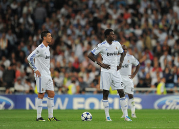 MADRID, SPAIN - APRIL 27:  Emmanuel Adebayor (R) of Real Madrid stands dejected with his teammates Cristiano Ronaldo (L) and Lassana Diarra after conceding a goal during the UEFA Champions League Semi Final first leg match between Real Madrid and Barcelon