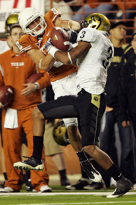 AUSTIN, TX - OCTOBER 10: Jordan Shipley #8 of the Texas Longhorns wrestles for control of the ball with cornerback Jimmy Smith #3 of the Colorado Buffaloes for an incomplete pass on October 10, 2009 at Darrell K Royal-Texas Memorial Stadium in Austin, Tex