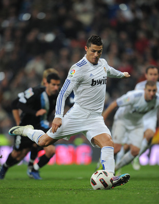 MADRID, SPAIN - MARCH 03:  Cristiano Ronaldo of Real Madrid strikes to score from the penalty spot during the la Liga match between Real Madrid and Malaga at Estadio Santiago Bernabeu on March 3, 2011 in Madrid, Spain.  (Photo by Jasper Juinen/Getty Image
