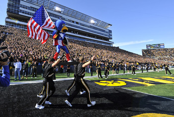 IOWA CITY, IA - OCTOBER 30- Dressed as Captain American Univeristy of Iowa mascot Herky the Hawk takes the field for the Michigan State Spartans NCAA football game at Kinnick Stadium on October 30, 2010 in Iowa City, Iowa. Iowa won 37-6 over Michigan Stat