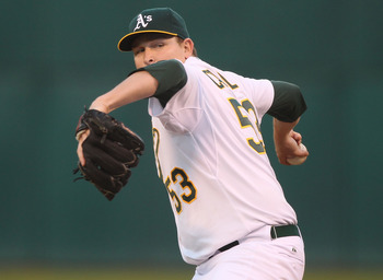 OAKLAND, CA - AUGUST 19:  Trevor Cahill #53 of the Oakland Athletics pitches against the Tampa Bay Rays during an MLB game at the Oakland-Alameda County Coliseum on August 19, 2010 in Oakland, California.  (Photo by Jed Jacobsohn/Getty Images)