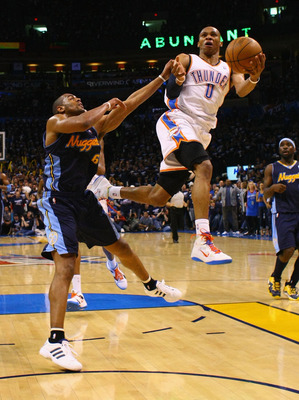 OKLAHOMA CITY, OK - APRIL 27: Russell Westbrook #0 of the Oklahoma City Thunder drives to the basket against Arron Afflalo #6 of the Denver Nuggets in Game Five of the Western Conference Quarterfinals in the 2011 NBA Playoffs on April 27, 2011 at the Ford
