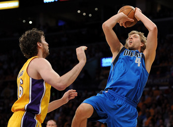 LOS ANGELES, CA - MAY 02:  Dirk Nowitzki #41 of the Dallas Mavericks shoots over Pau Gasol #16 of the Los Angeles Lakers in the first quarter in Game One of the Western Conference Semifinals in the 2011 NBA Playoffs at Staples Center on May 2, 2011 in Los