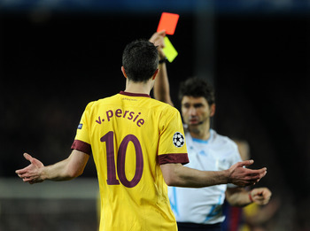 BARCELONA, SPAIN - MARCH 08:  Robin van Persie of Arsenal reacts as referee Massimo Busacca shows his a red card during the UEFA Champions League round of 16 second leg match between Barcelona and Arsenal on March 8, 2011 in Barcelona, Spain.  (Photo by J