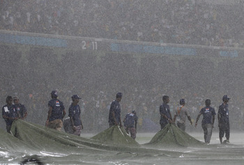 COLOMBO, SRI LANKA - MARCH 05:  Ground staff attempt to cover the outfield as heavy rain halts play during the Australia v Sri Lanka 2011 ICC World Cup Group A match at the R. Premadasa Stadium on March 5, 2011 in Colombo, Sri Lanka.  (Photo by Michael St