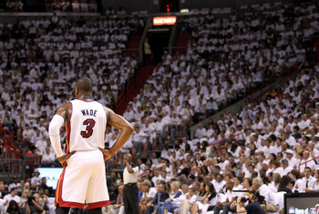 MIAMI, FL - MAY 01:  Dwyane Wade #3 of the Miami Heat looks on during Game One of the Eastern Conference Semifinals of the 2011 NBA Playoffs against the Boston Celtics at American Airlines Arena on May 1, 2011 in Miami, Florida. NOTE TO USER: User express