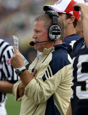 SOUTH BEND, IN - SEPTEMBER 11: Head coach Brian Kelly of the Notre Dame Fighting Irish watches as his team takes on the Michigan Wolverines at Notre Dame Stadium on September 11, 2010 in South Bend, Indiana. Michigan defeated Notre Dame 28-24.  (Photo by