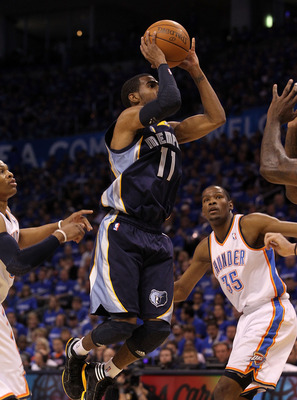 OKLAHOMA CITY, OK - MAY 01:  Guard Mike Conley #11 of the Memphis Grizzlies takes a shot against the Oklahoma City Thunder in Game One of the Western Conference Semifinals in the 2011 NBA Playoffs on May 1, 2011 at Oklahoma City Arena in Oklahoma City, Ok