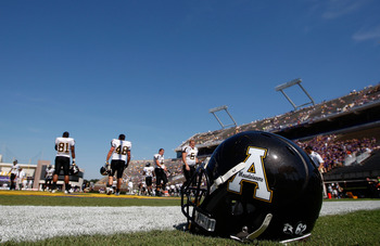 GREENVILLE, NC - SEPTEMBER 05:  A football helmet sits on the sideline during warm-ups before the start of the Appalachian State Mountaineers versus East Carolina Pirates at Dowdy-Ficklen Stadium on September 5, 2009 in Greenville, North Carolina.  (Photo