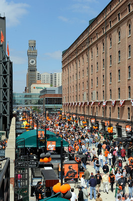 BALTIMORE - APRIL 09:  Fans walk down Eutaw Street before the game between the Baltimore Orioles and the Toronto Blue Jays on Opening Day at Camden Yards on April 9, 2010 in Baltimore, Maryland.  (Photo by Greg Fiume/Getty Images)