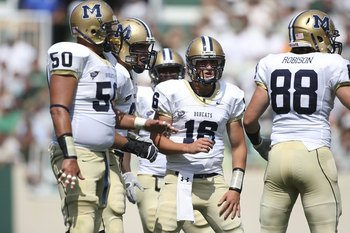 EAST LANSING, MI - SEPTEMBER 05:  Mark Iddins #16 of the Montana State Bobcats calls gathers his team during the first quarter against the Michigan State Spartans in the second quarter on September 5, 2009 at Spartan Stadium in East Lansing, Michigan. (Ph
