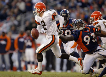 DENVER - DECEMBER 14:  Quarterback Tim Couch #2 of the Cleveland Browns runs out of the pocket on a flea flicker against defensive end Trevor Pryce #93 of the Denver Broncos December 14, 2003 at Invesco Field at Mile High in Denver, Colorado. The Broncos