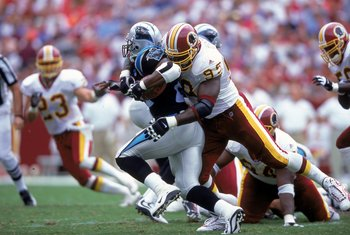 3 Sep 2000: Dan Wilkinson #95 of the Washington Redskins tackles Tshimanga Biakabutuka #21 of the Carolina Panthers at the FedEx Field in Landover, Maryland. The Redskins defeated the Panthers 20-17.Mandatory Credit: Ezra O. Shaw  /Allsport