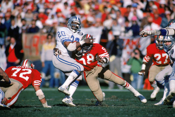 SAN FRANCISCO - 1983:  Running back Billy Sims #20 of the Detroit Lions gets tackled during a game against the San Francisco 49ers in a 1983 NFL season game at Candlestick Park in San Francisco, California.  (Photo by Getty Images)