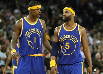 OAKLAND, CA - JANUARY 7:  Baron Davis #5 and Stephen Jackson #1 of the Golden State Warriors look on during an NBA game against the San Antonio Spurs at Oracle Arena January 7, 2008 in Oakland, California. NOTE TO USER: User expressly acknowledges and agr