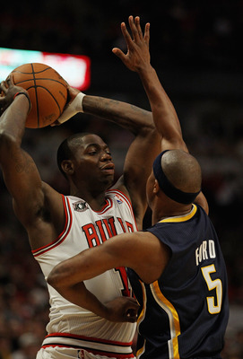 CHICAGO, IL - APRIL 18: Ronnie Brewer #11 of the Chicago Bulls tries to pass over the defense of T.J. Ford #5 of the Indiana Pacers in Game Two of the Eastern Conference Quarterfinals in the 2011 NBA Playoffs at the United Center on April 18, 2011 in Chic