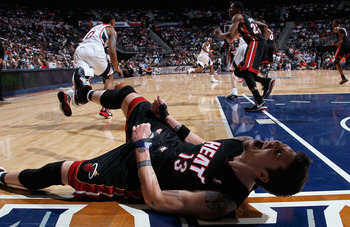 ATLANTA, GA - APRIL 11:  Mike Miller #13 of the Miami Heat reacts after battling for a loose ball against the Atlanta Hawks at Philips Arena on April 11, 2011 in Atlanta, Georgia.  NOTE TO USER: User expressly acknowledges and agrees that, by downloading 