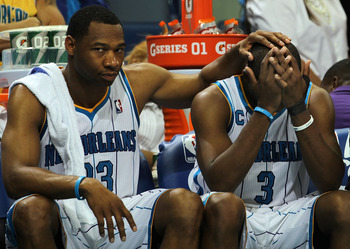 NEW ORLEANS, LA - APRIL 28:  (L-R) Willie Green #33 and Chris Paul #3 of the New Orleans Hornets react on the bench during a 98-80 loss against the Los Angeles Lakers in Game Six of the Western Conference Quarterfinals in the 2011 NBA Playoffs on April 28