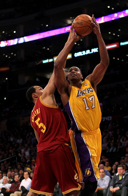LOS ANGELES, CA - JANUARY 11:   Andrew Bynum #17 of the Los Angeles Lakers shoots over Ryan Hollins #5 the Cleveland Cavaliers at Staples Center on January 11, 2011 in Los Angeles, California.   NOTE TO USER: User expressly acknowledges and agrees that, b