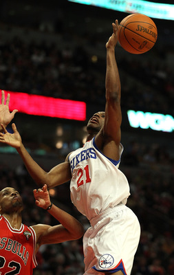 CHICAGO, IL - MARCH 28: Thaddeus Young #21 of the Philadelphia 76ers looses control of the ball going up for a shot against Taj Gibson #22 of the Chicago Bulls at the United Center on March 28, 2011 in Chicago, Illinois. NOTE TO USER: User expressly ackno
