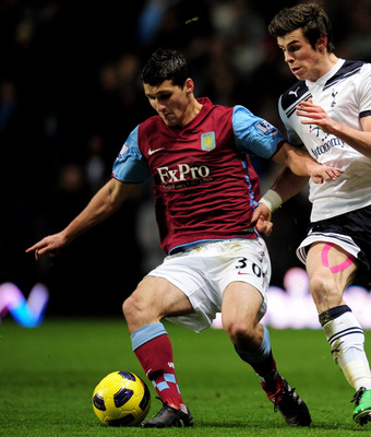 BIRMINGHAM, ENGLAND - DECEMBER 26:  Eric Lichaj (L) of Aston Villa in action against Gareth Bale (R) of Tottenham during the Barclays Premier League match between Aston Villa and Tottenham Hotspur at Villa Park on December 26, 2010 in Birmingham, England.
