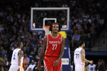 OAKLAND, CA - DECEMBER 20:  Jordan Hill #27 of the Houston Rockets in action against the Golden State Warriors at Oracle Arena on December 20, 2010 in Oakland, California. NOTE TO USER: User expressly acknowledges and agrees that, by downloading and or us