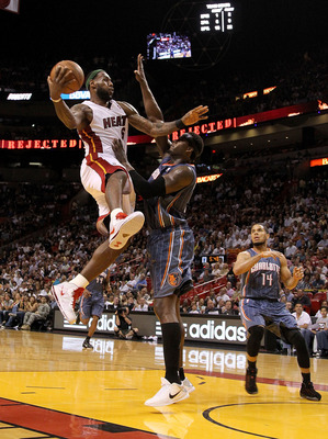 MIAMI, FL - APRIL 08:  LeBron James #6 of the Miami Heat drives against Kwame Brown #54 of the Charlotte Bobcats during a game at American Airlines Arena on April 8, 2011 in Miami, Florida. NOTE TO USER: User expressly acknowledges and agrees that, by dow