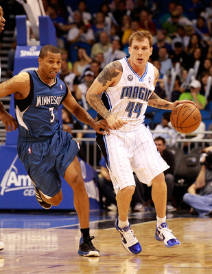 ORLANDO, FL - NOVEMBER 03:  Jason Williams #44 of the Orlando Magic drives past Sebastian Telfair #3 of the Minnesota Timberwolves during the game at Amway Arena on November 3, 2010 in Orlando, Florida.  NOTE TO USER: User expressly acknowledges and agree