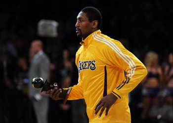 LOS ANGELES, CA - APRIL 26:  Ron Artest #15 of the Los Angeles Lakers is presented with the J. Walter Kennedy Citizenship Award for his charitable efforts before taking on the New Orleans Hornets in Game Five of the Western Conference Quarterfinals in the