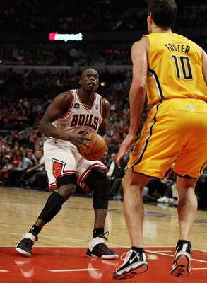 CHICAGO, IL - APRIL 26: Loul Deng #9 of the Chicago Bulls prepares to shoot against Jeff Foster #10 of the Indiana Pacers in Game Five of the Eastern Conference Quarterfinals in the 2011 NBA Playoffs at the United Center on April 26, 2011 in Chicago, Illi