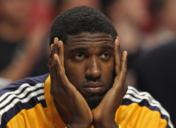 CHICAGO, IL - APRIL 26: Roy Hibbert #55 of the Indiana Pacers watches his teammates take on the Chicago Bulls from the bench in Game Five of the Eastern Conference Quarterfinals in the 2011 NBA Playoffs at the United Center on April 26, 2011 in Chicago, I