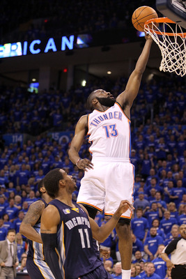 OKLAHOMA CITY, OK - MAY 03:  Guard James Harden #13 of the Oklahoma City Thunder takes a shot against Mike Conley #11 of the Memphis Grizzlies in Game Two of the Western Conference Semifinals in the 2011 NBA Playoffs on May 3, 2011 at Oklahoma City Arena