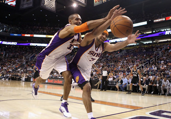 PHOENIX, AZ - APRIL 13:  Grant Hill #33 and Jared Dudley #3 of the Phoenix Suns reach for a loose ball during the NBA game against the San Antonio Spurs at US Airways Center on April 13, 2011 in Phoenix, Arizona.  NOTE TO USER: User expressly acknowledges