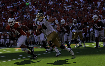 AUSTIN, TX - SEPTEMBER 25:  Quarterback Kevin Prince #4 of the UCLA Bruins runs the ball past Jackson Jeffcoat #44 of the Texas Longhorns at Darrell K Royal-Texas Memorial Stadium on September 25, 2010 in Austin, Texas.  (Photo by Ronald Martinez/Getty Im
