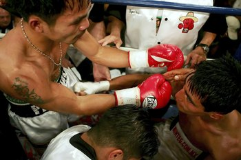LAS VEGAS - NOVEMBER 18:  (L-R) Manny Pacquiao of the Philippines goes over to hug Erik Morales of Mexico after their super featherweight bout at the Thomas & Mack Center on November 18, 2006 in Las Vegas, Nevada. Pacquiao won after a third round knockout