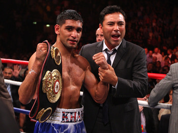 MANCHESTER, ENGLAND - APRIL 16:  Amir Khan celebrates after with Oscar de la Hoya after victory over Paul McCloskey in the WBA Light-Welterweight Championship fight between Amir Khan and Paul McCloskey at MEN Arena on April 16, 2011 in Manchester, England