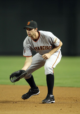 PHOENIX, AZ - APRIL 16:  Infielder Brandon Belt #9 of the San Francisco Giants in action during the Major League Baseball game against the Arizona Diamondbacks at Chase Field on April 16, 2011 in Phoenix, Arizona.  The Giants defeated the Diamondbacks 5-3