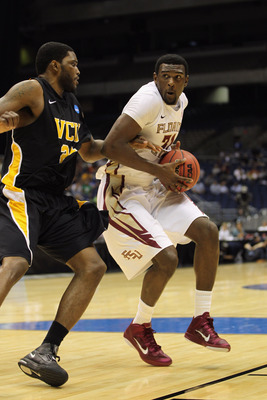 SAN ANTONIO, TX - MARCH 25:  Chris Singleton #31 of the Florida State Seminoles handles the ball against Jamie Skeen #21 of the Virginia Commonwealth Rams during the southwest regional of the 2011 NCAA men's basketball tournament at the Alamodome on March
