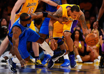 LOS ANGELES, CA - MAY 02:  Shannon Brown #12 of the Los Angeles Lakers goes after the ball as Jason Terry #31 of the Dallas Mavericks goes down next to him in the first quarter in Game One of the Western Conference Semifinals in the 2011 NBA Playoffs at S