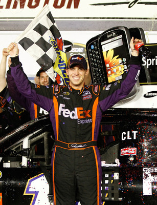 DARLINGTON, SC - MAY 08:  Denny Hamlin, driver of the #11 FedEx Express Toyota, celebrates in victory lane after he won the NASCAR Sprint Cup series SHOWTIME Southern 500 at Darlington Raceway on May 8, 2010 in Darlington, South Carolina.  (Photo by Jason
