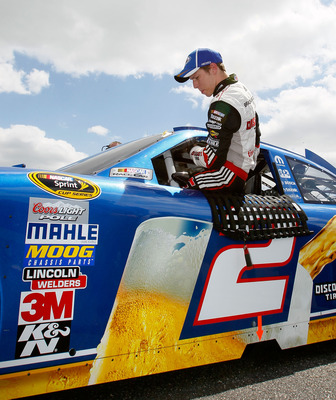 TALLADEGA, AL - APRIL 16:  Brad Keselowski, driver of the #2 Miller Lite Dodge, climbs out of his after qualifying for the NASCAR Sprint Cup Series Aaron's 499 at Talladega Superspeedway on April 16, 2011 in Talladega, Alabama.  (Photo by Kevin C. Cox/Get