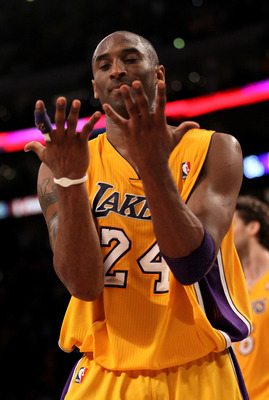 LOS ANGELES, CA - APRIL 5:  Kobe Bryant #24 of the Los Angeles Lakers looks at his hands as he walks off the court after losing control of the ball while going for the potential game winning shot in the final seconds against the Utah Jazz at Staples Cente